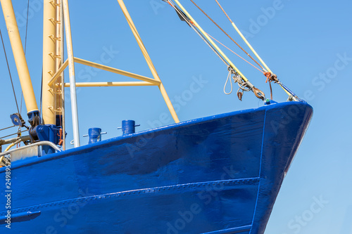 Bow shrimp fishing ship in Dutch harbor Lauwersoog Fotobehang