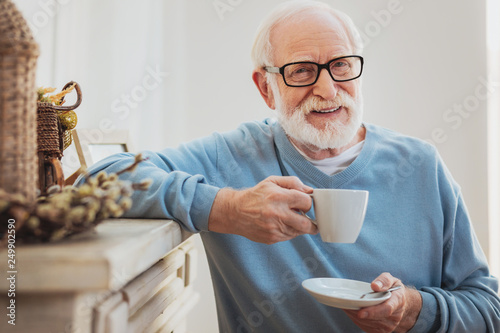 Fotografie, Obraz  Smart elderly man drinking coffee while having break