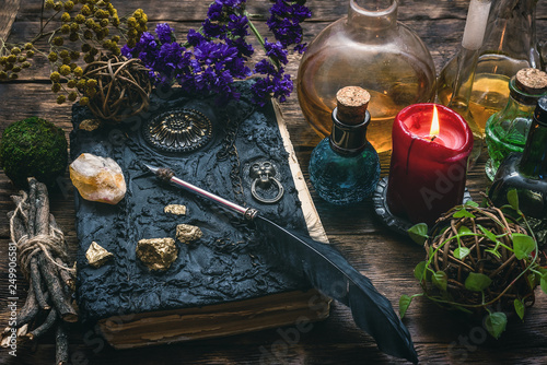 Leinwand Poster Spell book, magic potions and other various witchcraft accessories on the wizard table background
