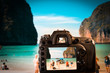 DSLR camera focus on Maya bay, afamous beach in Koh Phi Phi Leh. It has become even more popular after several movies filmed there
