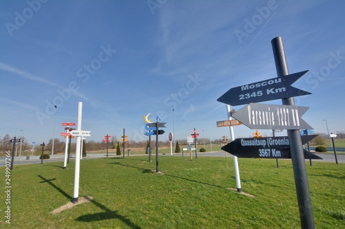 Direction signs in wood showing the distance of the main towns of the world Canvas Print