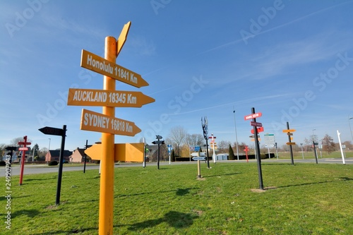 Direction signs showing the distance of the main town of the world Canvas Print