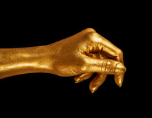 Hand Gesture. Hand In Gold Paint, Shiny, Metallic. Isolated On Black Background.