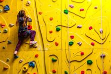 Little Girl On Climbing In Entertainment Center.