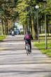 A person riding a bicycle through a park