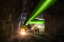 Miners Inspecting An Underground Ventilation System In A Gold Mine In Australia