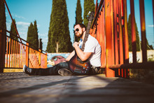 Outdoor Photo Session With A Bass Player And His Instruments