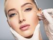 Leinwandbild Motiv Woman getting cosmetic injection of botox in cheek