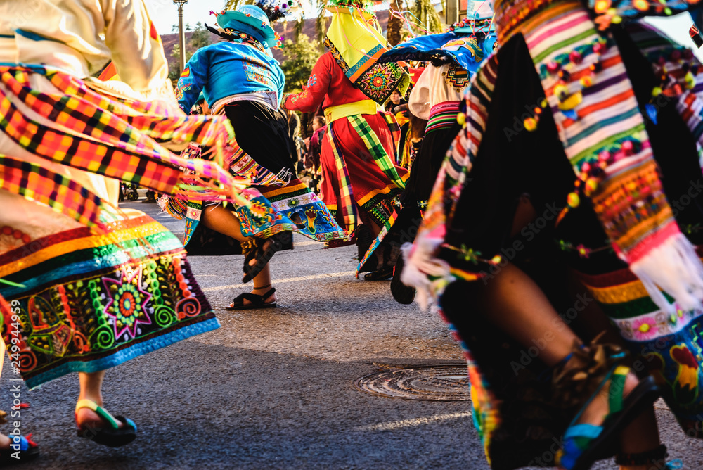 Fototapety, obrazy: Valencia, Spain - February 16, 2019: Detail of the colorful traditional Bolivian party outfit during a carnival parade showing folklore typical of Latin countries with dancing dancers.