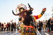 Leinwanddruck Bild Valencia, Spain - February 16, 2019: Man disguised as a shaman with a ceremonial bull wearing the traditional Bolivian party outfit during a carnival parade.