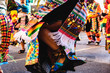 Leinwanddruck Bild Valencia, Spain - February 16, 2019: Detail of the colorful traditional Bolivian party outfit during a carnival parade showing folklore typical of Latin countries with dancing dancers.
