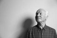 Portrait Of Elderly Man On Light Background, Space For Text. Black And White Effect