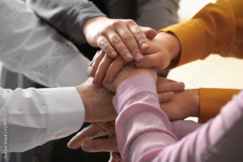 Fototapety, obrazy: Young people putting their hands together on blurred background, closeup