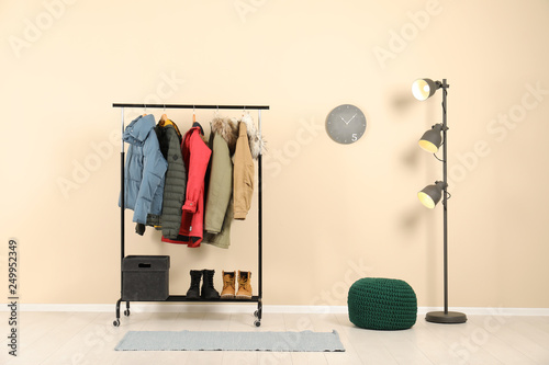 Canvas Stylish hallway interior with clothes on hanger stand