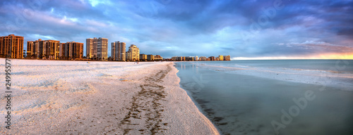 Aluminium Prints Dark grey Sunset and clouds over the calm water of Tigertail Beach on Marco Island