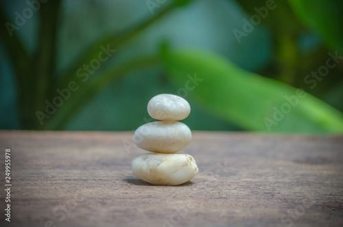 Photo Stands Water lilies Stone on the old wooden background