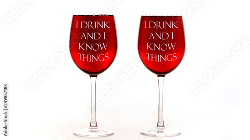 Photo  Red wine glasses with I drink and I know things text on white background