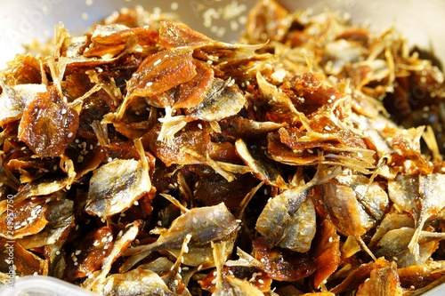 Fotografija  Yellow stripe scad, Dried fish with White Sesame Seeds in thailand market