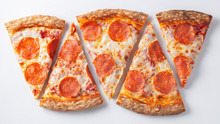 Pepperoni Pizza Slices On White Background. Top.