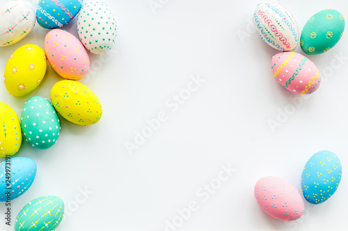 Fotografie, Obraz Decorated Easter eggs on white background border space for text