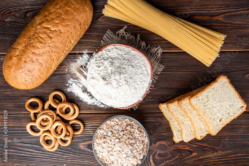 Fotografia, Obraz  Wheat products on dark wooden background