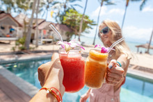 Beautiful With Tropical Cocktails Cheers Woman. Celebration Party. Summer Beach Concept. Nature Concept. Restaurant Beverage Drink Concept. Summer Vacation.