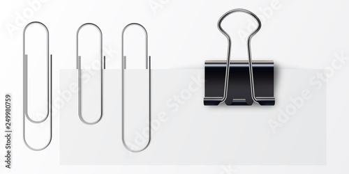 Fotografie, Obraz  Paper clip on paper. Set of paper clip with black binder