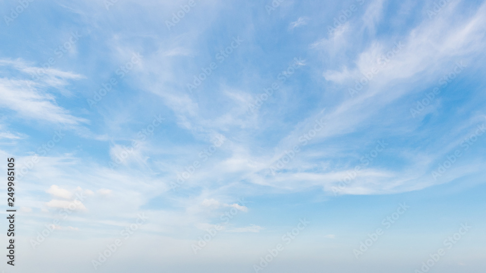 Fototapeta Beautiful clouds with blue sky background. Nature weather.cloud is water vapour in the atmosphere that has condensed into very small water droplets or ice crystals that appear in visible shapes