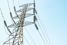 High Voltage Electricity Pylon For Electric Supply Transmission With Blue Sky, Power Distribution Technology And Generator Infracstructure Equipment