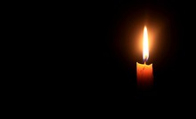 Yellow Candle Burn Against Darkness As Light For Life