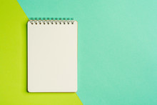 Top View Of Spiral Notepad On Colored Surface. Flat Lay Style With Place For Text. Trendy Color Concept. Color Of The Year.