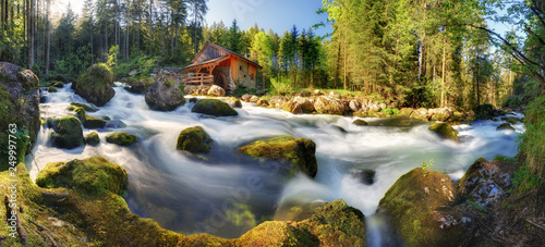 Photo Stands Forest river Austria landscape with waterfall and watermill near Salzburg, Golling Alps