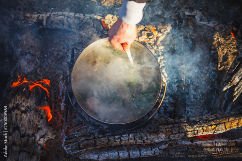 Fotografie, Obraz  Cooking in a pot on the fire in the spring of red fish soup