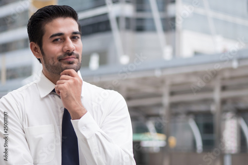 Fotografía  asian business man thinking; portrait of Asian, north indian successful and conf