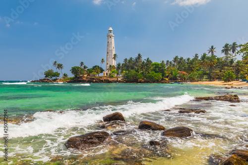 Fototapeta White lighthouse Dondra Head and tropical palms, Sri Lanka, near Matara