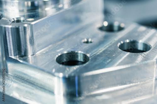 Fényképezés  Detail of aluminum machined parts, shiny surface.