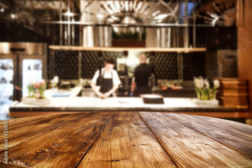 Table background of free space and kitchen interior of restaurant Canvas-taulu