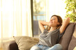 canvas print picture - Happy woman resting comfortably at home