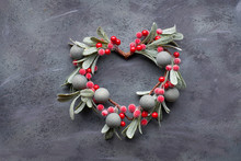 Christmas Flat Lay With Mistletoe Wreath On Dark