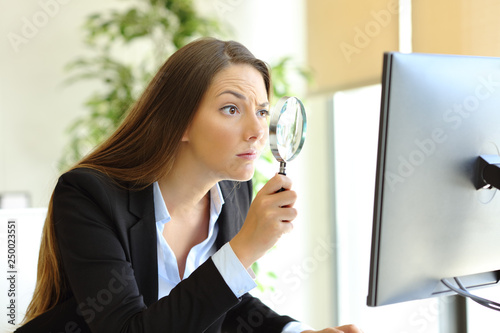 Suspicious office worker checking online content