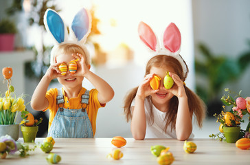 Happy easter! funny funny children   with ears hare getting ready for  holiday.