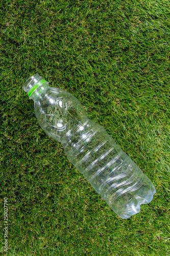 Fotografie, Obraz  A single plastic bottle on grass