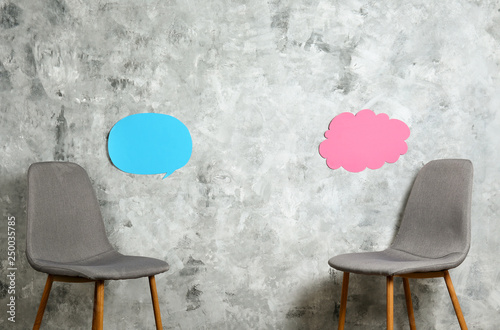 Empy loft style chair over blank wall background wit a lot of copy space for text Canvas Print