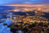 Fototapeta Miasto - Beautiful aerial cityscape view of the city of Leiden, the Netherlands, after sunset at night in the blue hour