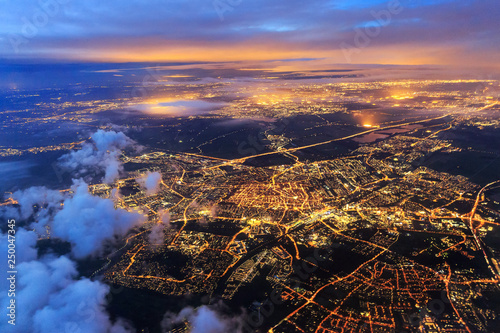 Beautiful aerial cityscape view of the city of Leiden, the Netherlands, after sunset at night in the blue hour - 250047345