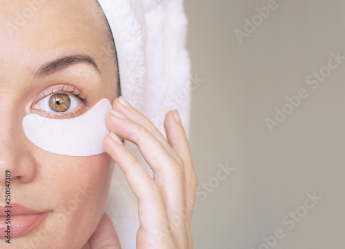 Fotografie, Tablou girl with patches under the eyes from wrinkles