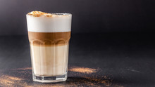 A Modern, Lactose-free Latte Or Cappuccino Coffee With Almond Milk. Above The Fire Sugar Burned Sugar. Caramel Crust. Drink In A Glass Tumbler. Copy Space