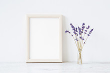 Dried Purple Lavender In Vase On Shelf At Light Gray Wall. Mockup For Positive Idea. Empty Place For Inspirational, Emotional, Sentimental Text, Quote, Sayings Or Photo In White Frame. Front View.