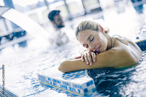 Portrait of beautiful woman relaxing in swimming pool