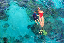 Happy Family - Mother, Kid In Snorkeling Mask Dive Underwater, Explore Tropical Fishes In Coral Reef Sea Pool. Travel Active Lifestyle, Beach Adventure, Swimming Activity On Summer Holiday With Child.